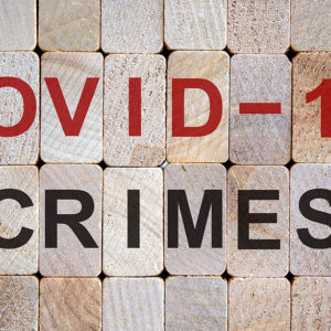 blocks with the words covid-19-crimes stenciled