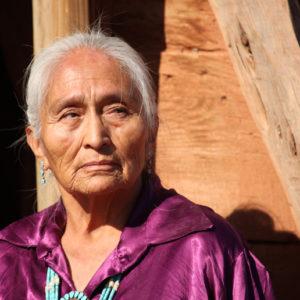 older Navajo woman standing in sunshine