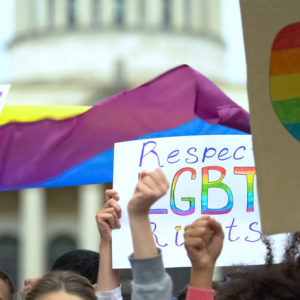 Crowd raising posters chanting to respect LGBT rights