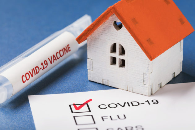 Vaccine, toy house and form with confirmed result on coronavirus. Concept on home treatment covid-19