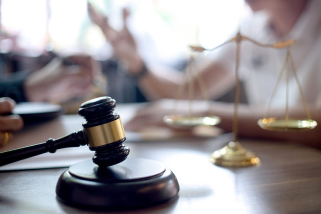 Lawyer or judge gavel with balance work with client or customer about agreement