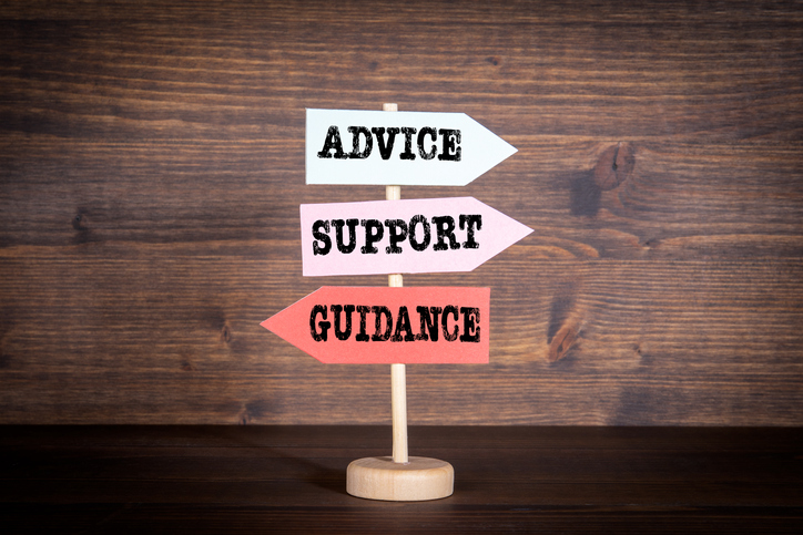 Signpost with arrows - Advice, Support and Guidance.